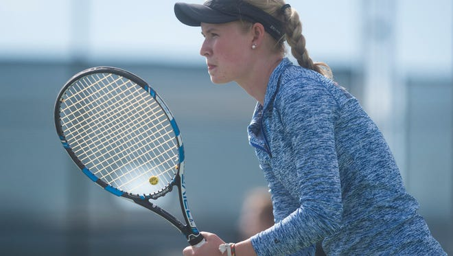 Ky Ecton, Poudre High School's No. 1 singles player, awaits a serve during a match last month against Fossil Ridge. Ecton won her first two matches Thursday at the Class 5A state tournament in Denver to advance to Friday's semifinals.