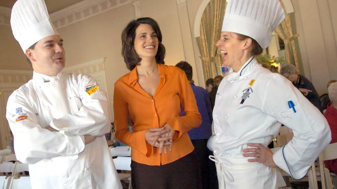 In this Jan. 27, 2006 photo, former WTAE anchor Wendy Bell, center, chats with chefs Scott Fetty and Andrea Schrenk while attending the Women's Board Luncheon 2006 Benefit at the Fox Chapel Golf Club,in Pittsburgh. Pittsburgh television station WTAE said it ended its relationship with Bell over racial comments she posted on Facebook about a deadly mass shooting in a black neighborhood near Pittsburgh. (Steve Mellon/Pittsburgh Post-Gazette via AP)