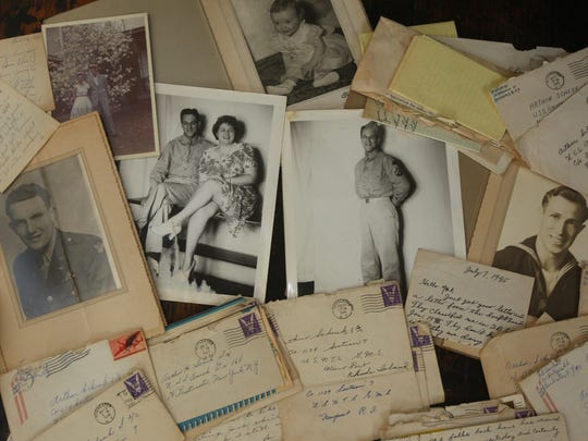 Among the items that Linda Whitney has collected are these letters and photos that belonged to Arthur Schenk, who served in the Navy during World War II.