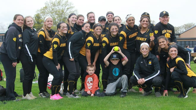 St. John Vianney poses with game ball for Jenn Retzer after Saturday's victory over Red Bank Catholic.