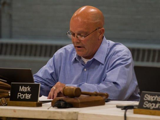 Burlington School Board Chair Mark Porter announces