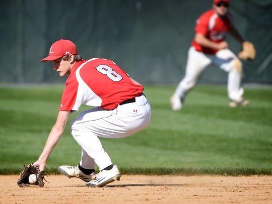 Annville-Cleona's Eli Setlock (8) scoops up a ground