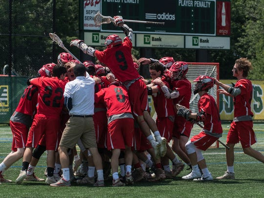 CVU celebrates the championship during the Division I boys lacrosse championship game between the Champlain Valley Union Redhawks and the South Burlington Rebels at UVM's Virtue Field on Saturday June 10, 2017 in Burlington.