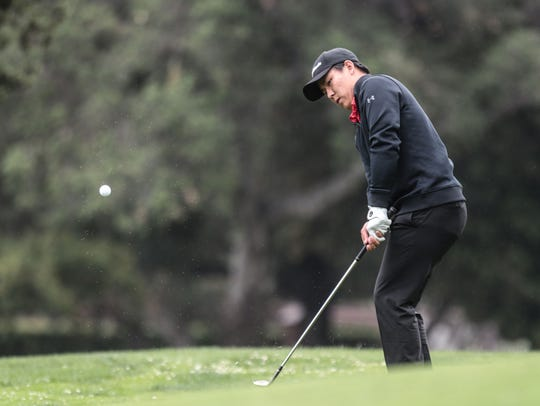 Palm Desert's Derick Liu on 14 green during the CIF-SCGA