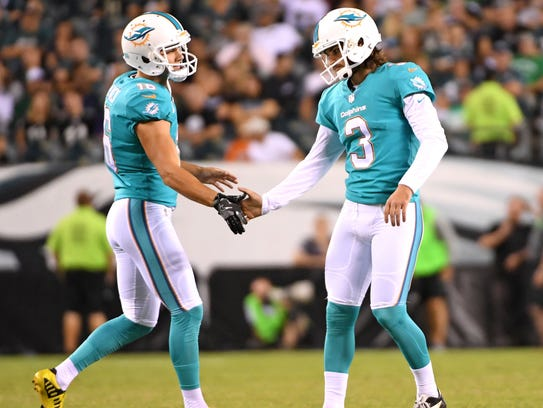 Matt Haack, left, is trying to make the Miami Dolphins'