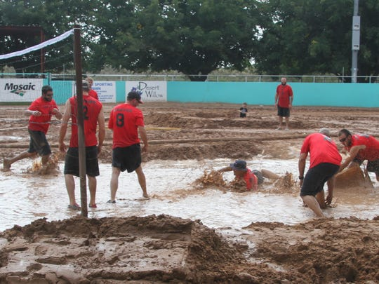 Many of the players on Xcel Energy's volleyball team, were not afraid to go face first into the mud in order to save the ball.