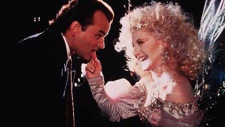 "Bill Murray and Carol Kane in a scene from the film ""Scrooged."""