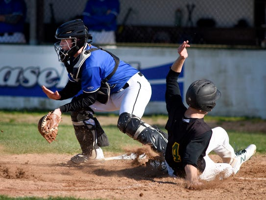Stephen Decatur catcher Zach Adams is forced to knock