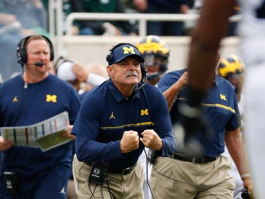 Michigan defensive coordinator Don Brown works against