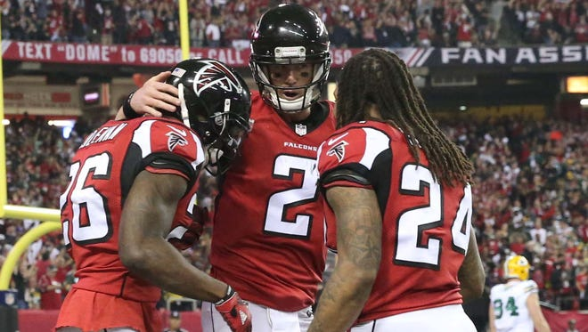 Matt Ryan (center) leads a potent Falcons offense and has shown excellent decision making under pressure.