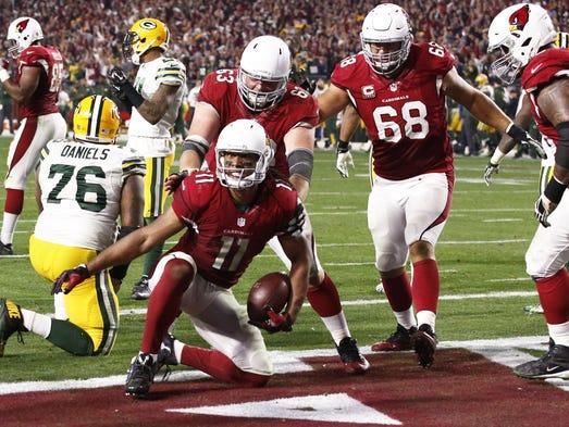 Cardinals Larry Fitzgerald scores winning touchdown