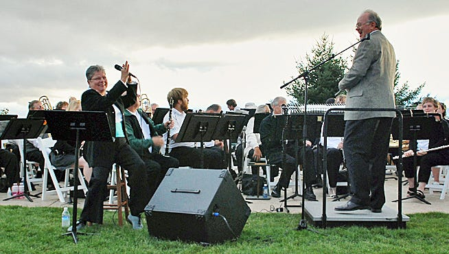 Soloist Chris Fletcher and Salem Concert Band conductor John Skelton applaud each other at a past vineyard evening. This year's vineyard event takes place 6 p.m. Sunday, Aug. 21, at The Youngberg Hill Vineyards & Inn in McMinnville.