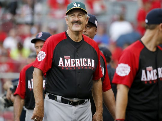 Rollie Fingers after the team scored a run.