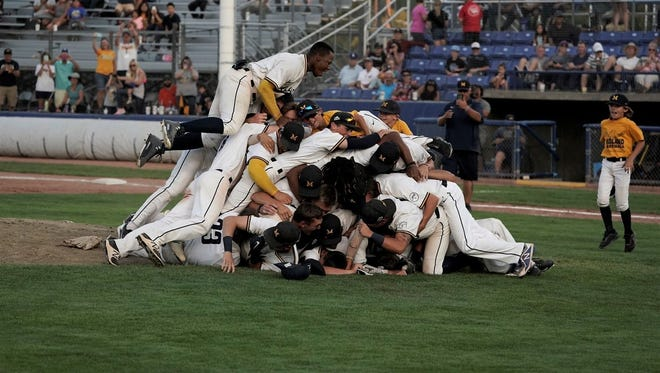 The Midland Redskins celebrate winning Saturday's Connie Mack World Series championship game against D-BAT at Ricketts Park. The Redskins have won back-to-back CMWS titles.  Jesse Hankins/Special to the Daily Times The Midland Redskins dog pile after winning Saturday's Connie Mack World Series championship game against D-BAT at Ricketts Park. The Redskins won back-to-back CMWS titles.