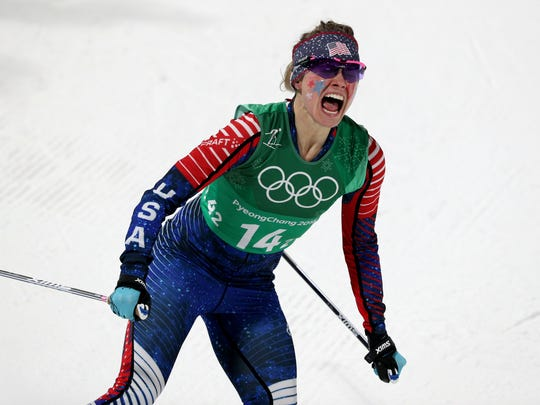 Jessie Diggins celebrates winning the gold medal in