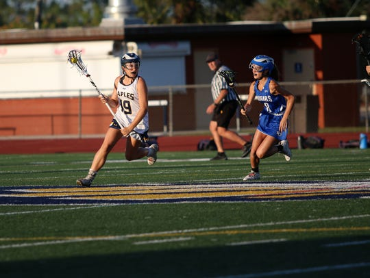 Naples sophomore Sophie Sullinger (19) runs up the
