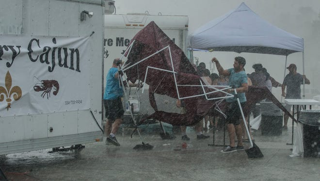The Country Cajun tent was blown down during a heavy storm at around 2 p.m. at the Food Truck Mash-Up on Saturday, June 9, at Riverfront Park in Montgomery.