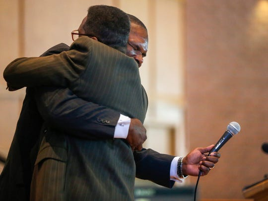 Al Jackson, right, hugs Andre Grinston after talking about plans to turn the Central Bible College campus into an education and treatment center for military veterans.
