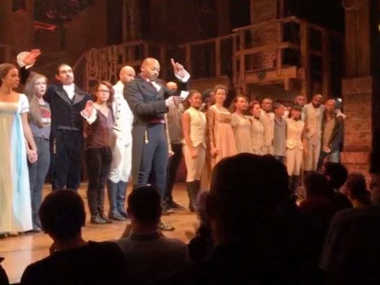 """In this image made from a video provided by Hamilton LLC, actor Brandon Victor Dixon (Aaron Burr) from """"Hamilton"""" spoke  after the curtain call in New York on Nov. 18."""