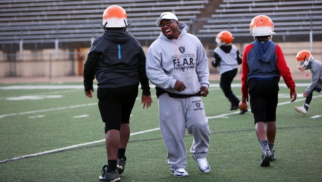 November 10, 2017 - Head coach Antonio Huntsman shares a light moment with members of his little league football team, the Orange Mound Raiders, at Melrose Stadium on Friday evening. The Mid-South Coliseum is being mothballed, much to the chagrin of preservation activists. Little has been said about what this means to Orange Mound residents, whose kids had high school graduation ceremonies there, and who for decades saw it as a part of their heritage.