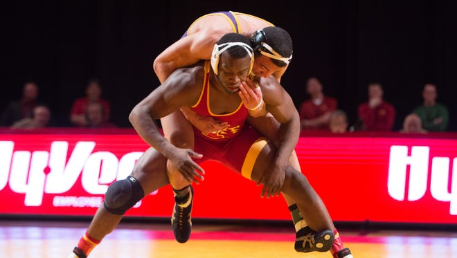 Iowa State University's Kyven Gadson tries to escape from UNI's Basil Minto in the 197-pound match Sunday, Feb. 15, 2015, during their dual meet at Hilton Coliseum in Ames.