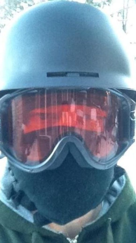 A selfie after a cold-weather bike ride in late 2014, with a helmet designed for downhill skiing and ski googles. I've got a new special winter helmet for this winter.