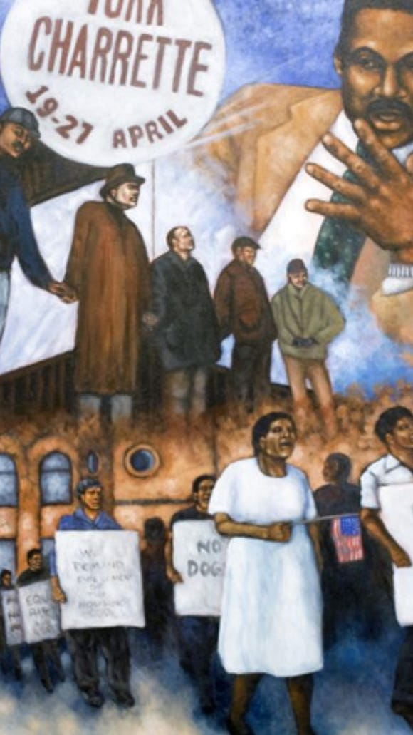 This is the center panel of the three sheets that make up mural 'Civil Rights Heroes - Barrier Breakers.' It features Bobby Simpson, longtime head of York's Crispus Attucks Community Center. This mural was painted by Bradley Academy students, coordinated by Brett Greiman.
