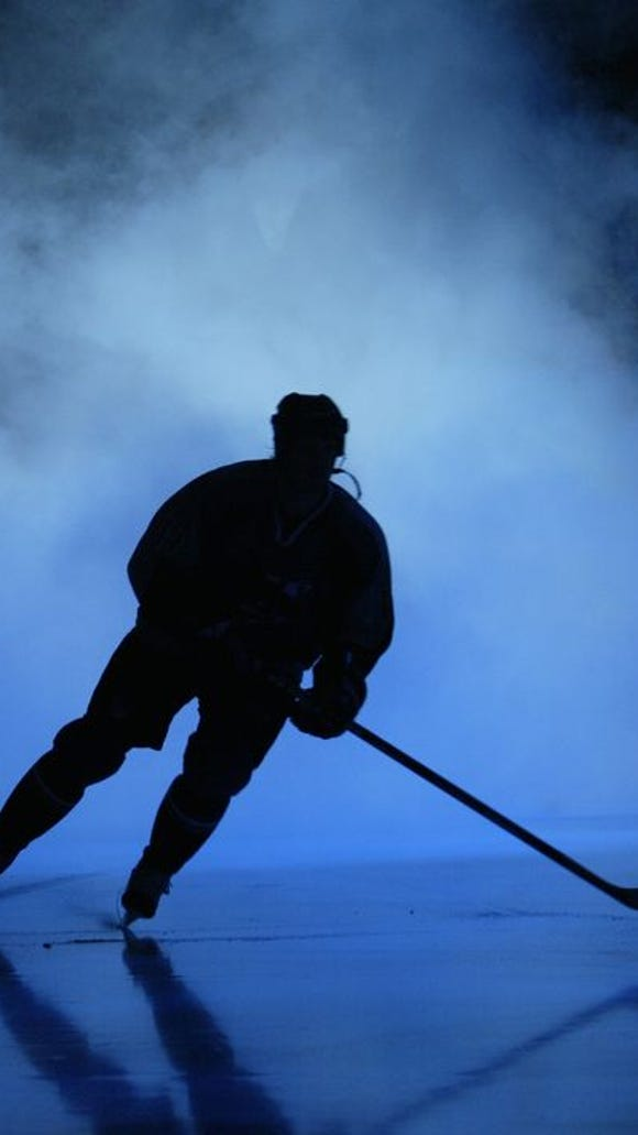 SAN JOSE, CA - APRIL 8: A player skates through the smoke during introductions prior to game one of the Western Conference quarterfinal series of the 2004 Stanley Cup Playoffs between the San Jose Sharks and the St. Louis Blues on April 8, 2004 at the HP Pavilion in San Jose, California. The Sharks defeated the Blues 1-0 in overtime.