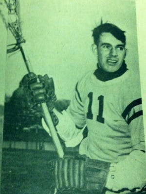 This is a picture of John McIntosh as a Navy lacrosse player from an old newspaper clipping.