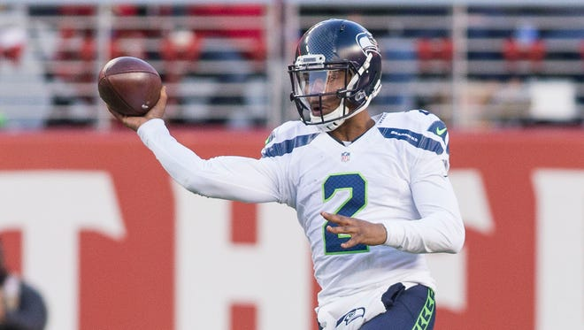 Seattle Seahawks quarterback Trevone Boykin (2) passes the football against San Francisco 49ers defensive end Chris Jones (93) during the fourth quarter at Levis Stadium.