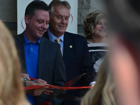 Michigan Works Southwest director Ben Damerow and State Senator Mike Nofs cut the ribbon at new Michigan Works Southwest building in Battle Creek.