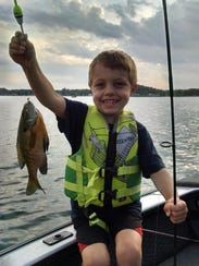 Nolan Kron, 4, is shown with a bluegill he caught during
