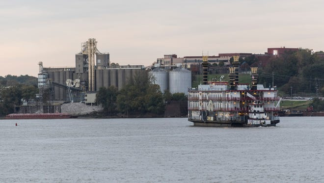 """The """"City of Evansville"""" riverboat moves down the Ohio River, leaving the spot it has been stationed at for over 22 years, in Evansville, Ind., Monday evening, Oct. 30, 2017. The casino boat will eventually depart for New Orleans, where it will become a floating Louis Armstrong jazz club/memorial/restaurant in New Orleans."""