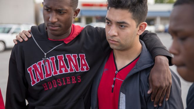 Corey Penick (left), and Raul Guerra, both 18, students at Warren Central High School, at an event hosted by Young Men, Inc., a youth ministry, to draw attention to gun violence near the site of the recent shootings of three boys from Warren Central High School, one of them fatally, 38th and Moller Road, Indianapolis, Monday, May 8, 2017.