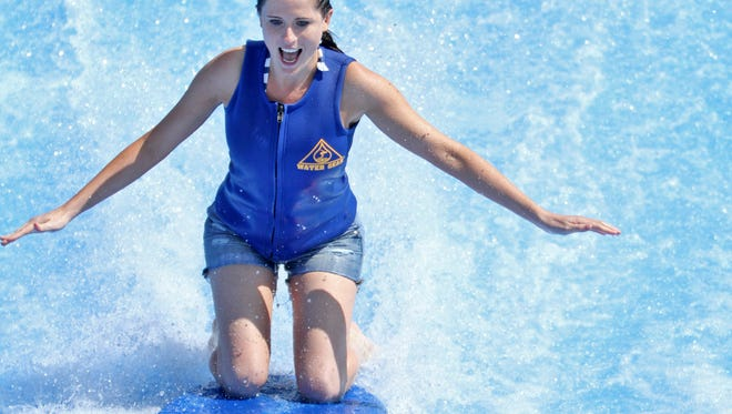 Adventuress Leslie Bailey tries the FlowRider, a new feature at the Monon Community Center Waterpark, May 15, 2012.