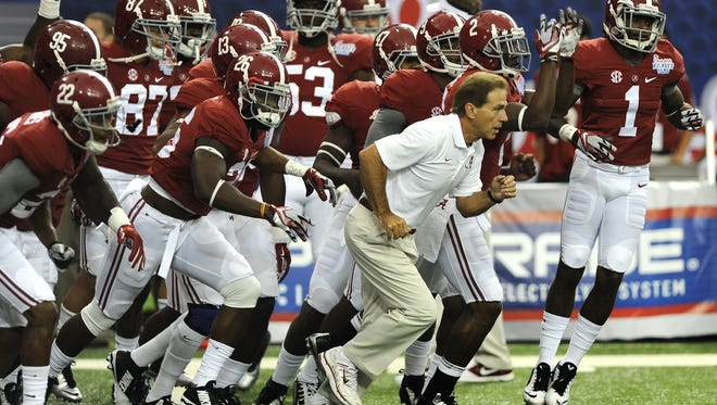 Mickey Welsh/Advertiser Alabama head caoch Nick Saban leads his team onto the field for warmups before the Chick-fil-A Kickoff Game against West Virginia at the Georgia Dome in Atlanta on. Coach Nick Saban leads his team onto the field for warmups before the Chick-fil-A Kickoff Game at the Georgia Dome in Atlanta, Ga. on Saturday August 30, 2014.