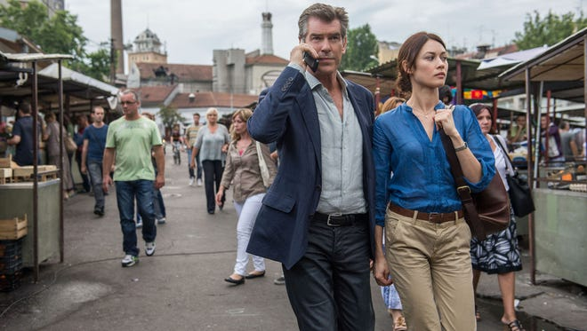 "Pierce Brosnan and Olga Kurylenko in a scene from the film ""The November Man."""