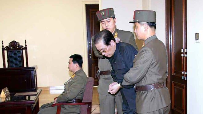 """Jang Song-thaek is escorted in court on December 12, 2013.  North Korea has executed him, the uncle of its leader Kim Jong Un, after a shock purge, state news agency KCNA announced early on Dec. 13, branding the once-powerful man a """"traitor."""""""