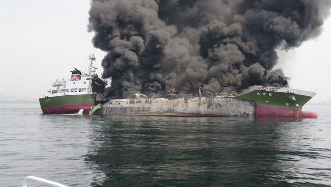 This handout picture taken and released by Japan's Coast Guard on May 29, 2014 shows black smoke rising from a 998-ton oil tanker off the coast of Hyogo prefecture, around 450 kilometres (280 miles) west of Tokyo. Japan's coastguard was rushing on May 29 to deal with an explosion and subsequent fire aboard a tanker off the country's coast, officials and the prime minister said.