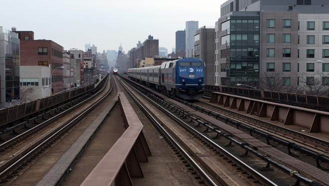 Trains run along the Park Avenue Viaduct   near the 125th street station in Manhattan March 10, 2014. A 58-year-old Yonkers man was struck by a Metro-North passenger train while he was working on the tracks near 106th Street  on the Park Avenue Viaduct.