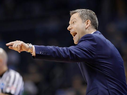 UMBC coach Ryan Odom directs his team against Kansas