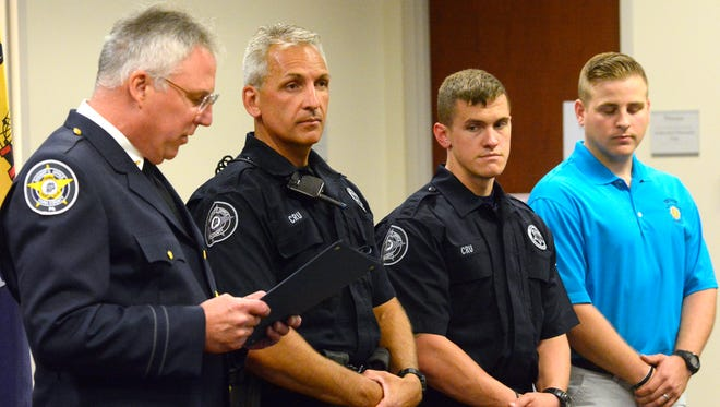 Sheriff Richard Keuerleber, left, presents Deputy Shane Becker, Deputy Cody Myers and now Trooper Wesley Johnson at Letter of Recognition during the York County Sheriff's Department awards and promotions ceremony at the York County Judicial Center, Friday, July 8, 2016.  John A. Pavoncello photo