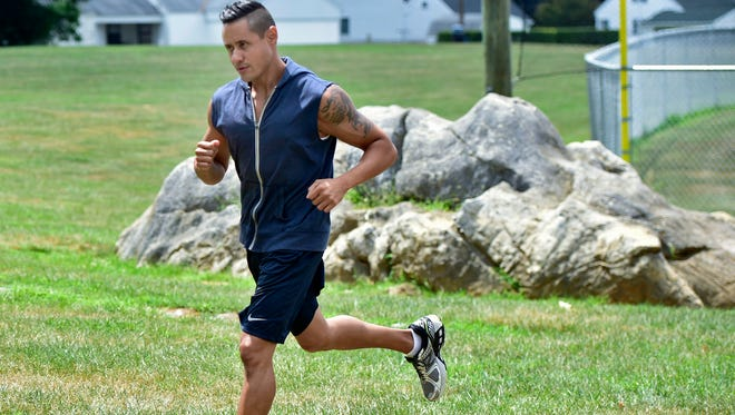 Frankie Serrano, a PURSUIT coach, goes through drills on Wednesday, August 3, 2016 at Chambersburg Memorial Park. The new concept takes fitness out of the gym and into the outdoors where partucipants find obsticles to overcome and jog to various locations.