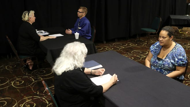 Smart Business Resource Center program advisors help job applicants practice mock interviews during the Work Readiness Event at the Win River Resort & Casino in 2016. Starting next week, the center is interviewing for Carr Fire cleanup jobs.
