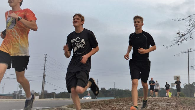 Nolan Hadden, a Prattville Christian freshman, runs with his team during a hill workout on Nov. 7, 2017. They are part of the school's first ever boys qualifying team for the AHSAA state cross country meet.