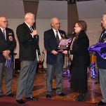 Evangel University was honored to be named a Purple Heart University this past year. Making the presentation to President Carol Taylor are Vietnam veterans and Purple Heart recipients Paul Schmitz Sr., John D. Dismer, Paul Weeks and Bruce Lockwood.