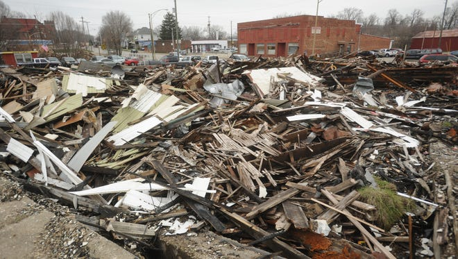 On Oct. 13, fire swept through two buildings at the corner of Luck Avenue and West Main Street in Zanesville. More than two months later, the remains of the buildings are still piled at the scene.