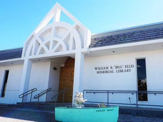 "The entrance to the William R. ""Bill"" Ellis Memorial Library remains boarded up on Tuesday, Jan. 30, 2018, in Port Aransas. The library was damaged by Hurricane Harvey in August 2017 and is still in need of repairs."