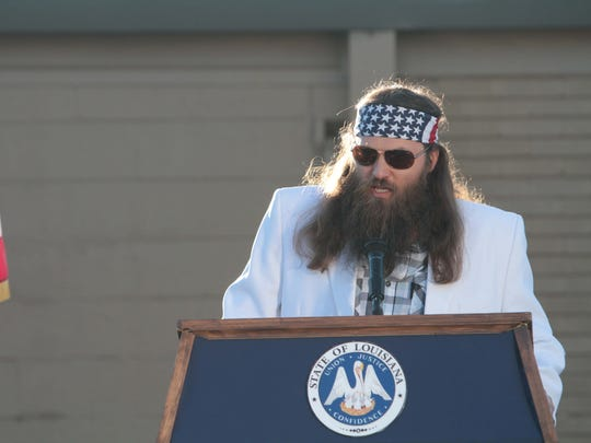 Willie Robertson receives the inaugural Governor's Award for Entrepreneurial Excellence at the Duck Commander warehouse in West Monroe.