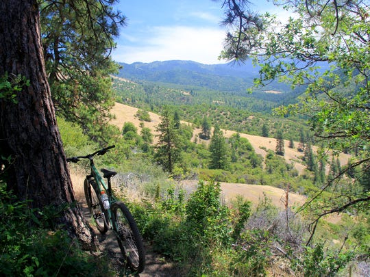 The views off the Sterling Ditch Mine Trail system, a fun mountain biking route, showcase the Applegate Valley. The trail is being considered for elevation to State Designated Scenic Trail status.